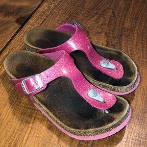 Well worn girls Birkenstock's pink sparkle